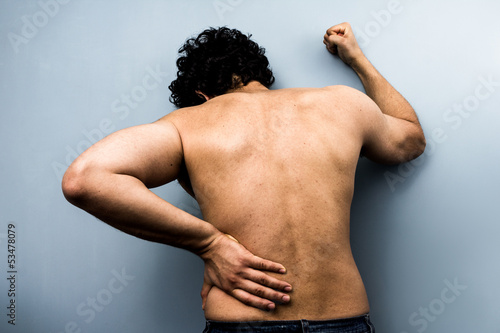 Young man with severe backpain from sciatica