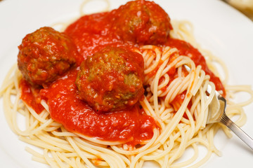 Twirling Spaghetti on Fork with Meatballs