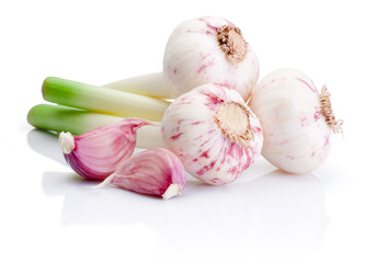 Three bulbs of fresh garlic and pieces isolated on white backgro