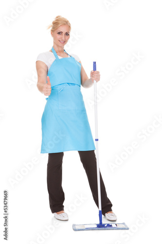 Portrait Of Woman Holding Broom