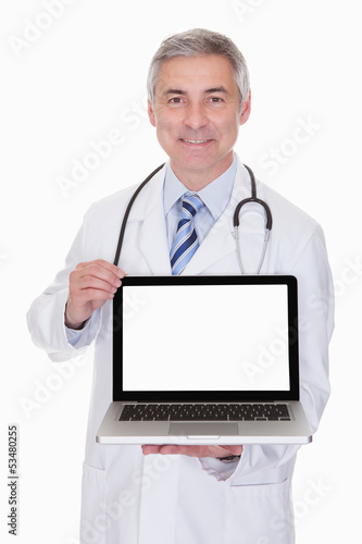 Portrait Of Male Doctor Showing Laptop