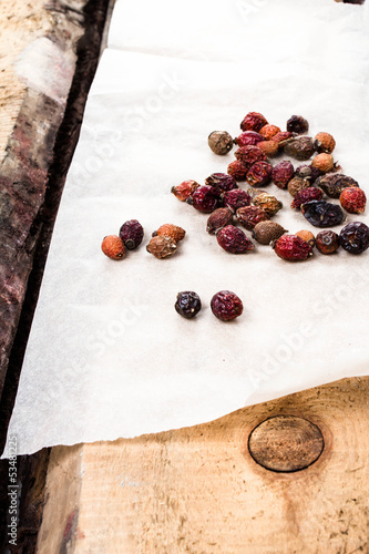 Dried rose hip on vintage wooden  table