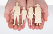 Male Hand Holding Family Cutout Shape