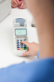 Finger Entering The Pin Code In Card Reader Machine