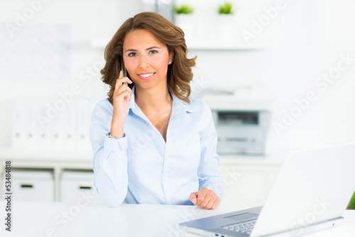 businesswoman with her cell phone in the office