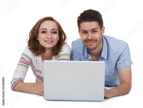 Young Happy Couple Using Laptop