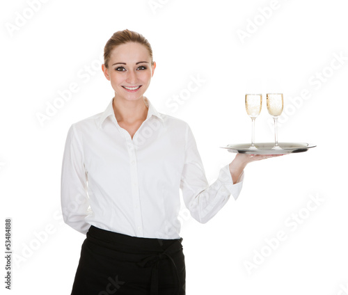 Waitress Carrying A Tray With Wine Glasses