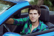 Handsome Man driving his car. Lifestyle, outdoors portrait