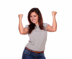 Excited hispanic young woman celebrating a victory