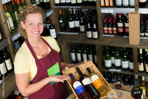 salesclerk presenting bottles of wine