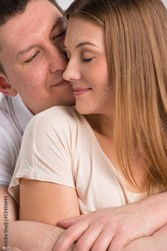 Portrait of a beautiful young happy smiling couple embracing