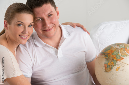 Portrait of happy romantic couple planning their vacation