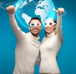 woman and man in 3d glasses looking at globe model