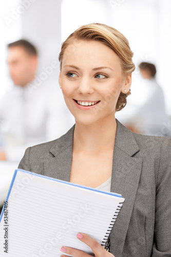 happy woman with big notepad