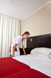 Housekeeping maid cleaning hotel room