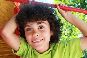 Outdoor portrait of a beautiful child with lovely smile
