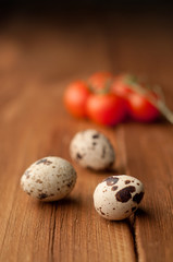 quail eggs on a wooden background