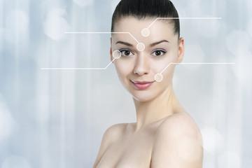 Beautiful brunette woman pointed wrinkles spots.