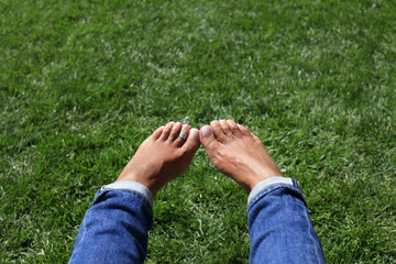 Bare feet in green grass