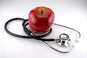 A stethoscope with a red apple