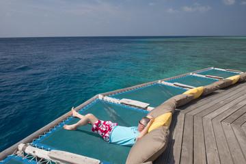 Man relaxing at Maldives