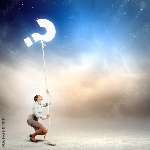 Woman pulling rope with a question mark
