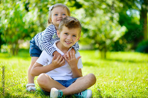 Happy sister and brother together in park
