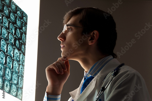 Man doctor looking at x-ray