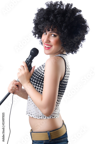 Pop star with mic  on white