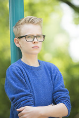 Confident teenager boy with glasses portrait