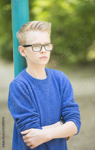 Confident teenager boy outdoor portrait