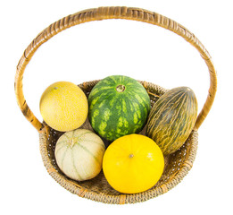 A variety of melons and honey dews in a basket