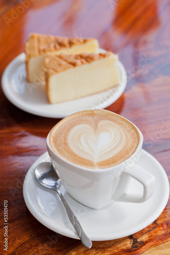 Cup of latte coffee with cake