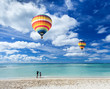 Colorful hot air balloon over the beach with blue sky