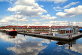 harbor at Reitdiephaven with sky reflected in water