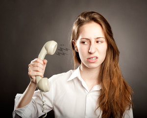 woman holding a telephone