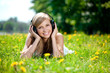 Beautiful smiling woman Woman listening to music on headphones o