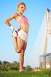 blond female fitness model outdoors