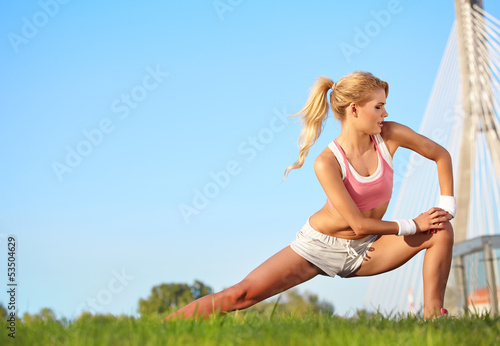 blond female fitness model outdoors