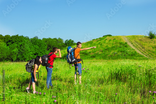 Backpackers observing the area