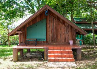 Wooden house or hut  in garden