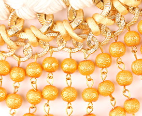 Golden pearls with macrame