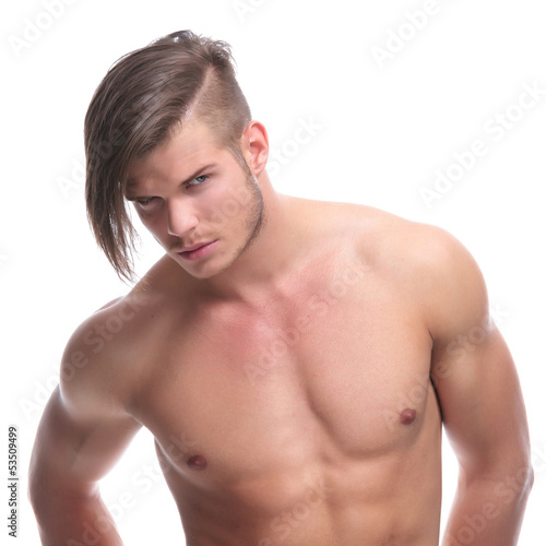 topless fashion man looks at camera