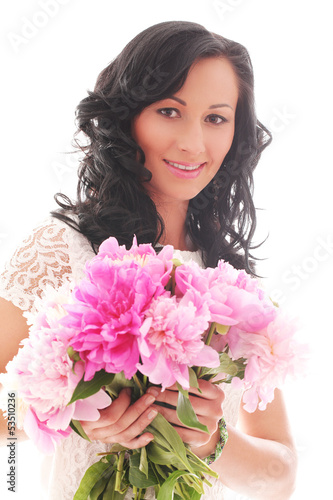 Beautiful young woman with bouquet of peonies
