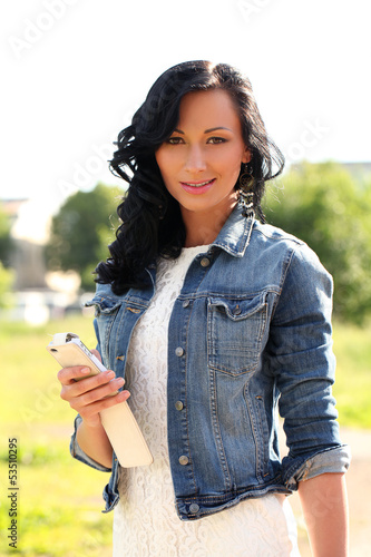 Beautiful caucasian woman with mobile phone