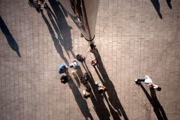 People seen from above with shadows