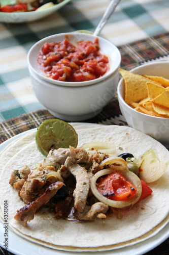 Mexican food with tortillas and nachos