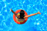 woman with swimsuit swimming in pool