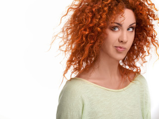 Red Hair. Funny Woman with Curly Long Hair against white backgro
