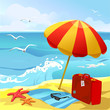 beach with sun umbrella and suitcase